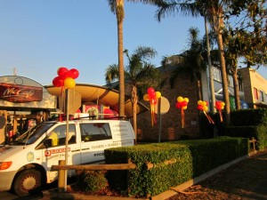 Balloon clusters decorate the Drive-thru, Mc Donald's Brookvale